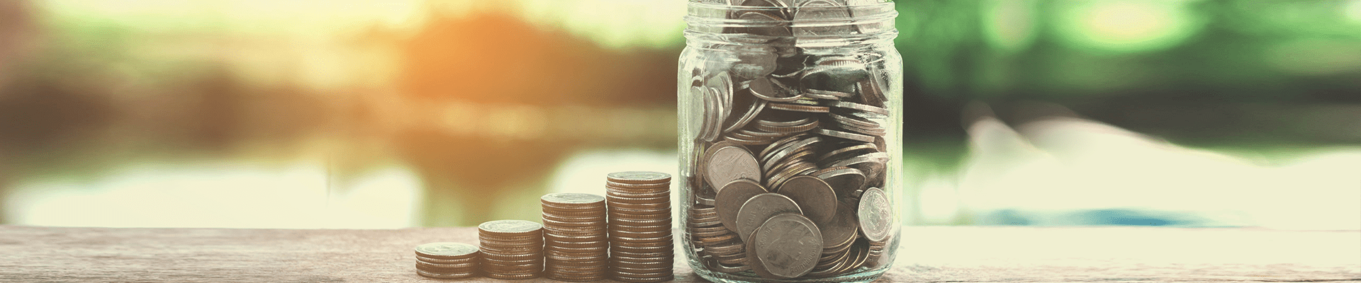 money jar and coins